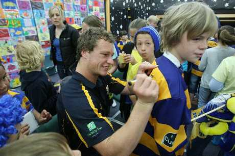 Bay of Plenty Steamers rugby player Jack Wilson signs student Isaac Fitzjohn's rugby jersey.