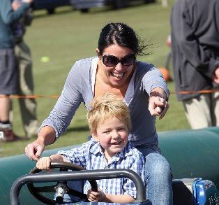 FREEWHEELING: Toby Anderson, 5, from Havelock North, takes the wheel with back seat driver Kirsty Holford.