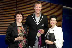 Designer Deryn Schmidt, Olympic rower Mahe Drysdale and reporter Rosie Dawson-Hewes at the New Zealand Fashion Week 2012 opening party on September 3.