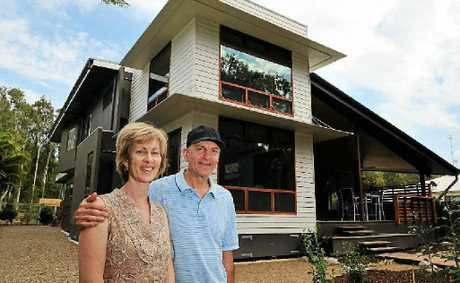 Karen and Joe Shlegeris and their environmentally friendly house.