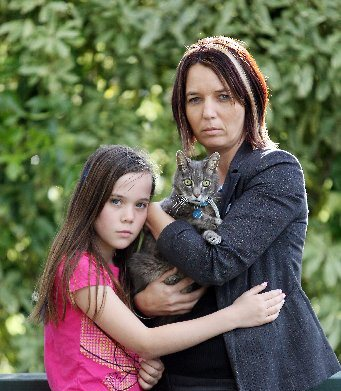Jo Oxenham and her daughter Alyssa, 10, were devastated to learn their cat, Maverick, has eight gun pellets in him and will have to be put down.