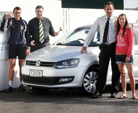 Detective Sergeant Pete Blackwell, New Zeal Foundation clients Tayla Mackie and Amon Rimene and  auctioneer Frank Vosper with a  donated 2012 VW Polo going under the hammer at this year's Tauranga 