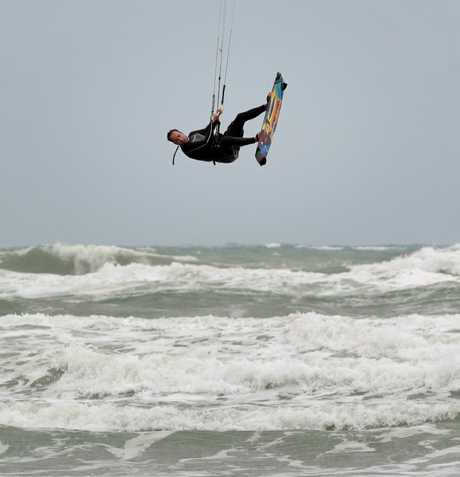 Kite surfers make good use of strong winds and large surf.