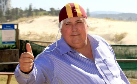 Mining billionaire Clive Palmer back at Greenmount surf club to collect his bronze medallion - an honour he earnt back in the 70s.