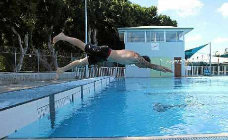 OPENING SOON: Memorial Baths worker Chris Sherring takes a dive.