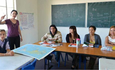 Mackay Language College principal Leigh Morgan (standing) instructs students Milena Cotto, Angel Guardales, Mia Yang, Jessica Paredes and Ritchie Corbita in English including Australian slang.