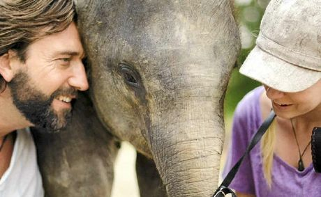 Murray Munro, Amanda French with Bona the baby elephant.