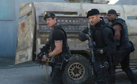 From left, Sylvester Stallone, Jason Statham and Terry Crews in a scene from the movie The Expendables 2.