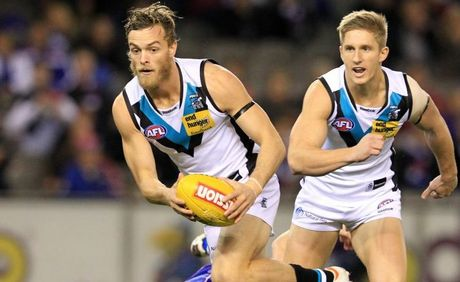 John McCarthy (left) in action for Port Adelaide during the AFL round twelve match between the Western Bulldogs and Port Adelaide at Etihad Stadium in Melbourne.