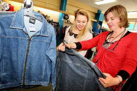 BARGAIN BUY: Hastings Cranford Hospice Shop manager Anke Hoggett-Schnebeck helps Aisha Wainwright to find the perfect denim jacket.