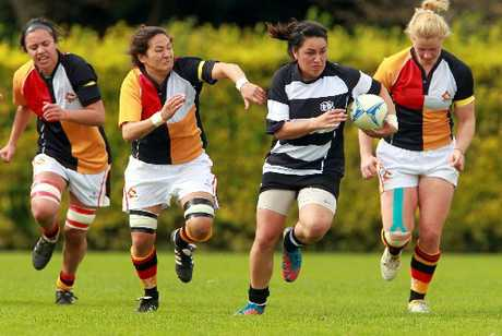 SIZZLING SYLVIA: Hawke's Bay Tuis first five-eighth Sylvia Bockman slices through the Waikato defence during her side's 34-24 loss at Park Island on Saturday.