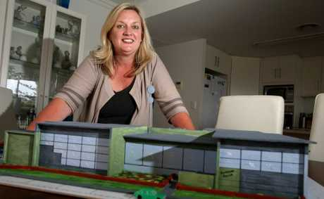 Carolyn Byrne with a model of the new police station in Kingscliff. Photo: John Gass / Daily News