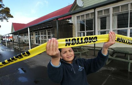 DANGER ZONE: Dannevirke South School's Kiana Kamura, 8, checks out the school's cordon after seven buildings were closed as a result of earthquake concerns. PHOTO/DUNCAN BROWN HBT123754-02