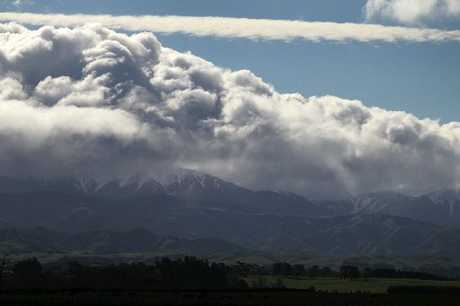 MERCURY FALLING: Storm clouds gather over the Ruahine Range near Ashley Clinton.PHOTO/DUNCAN BROWN HBT123755-07