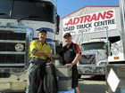 WINNER: Steven Birt wins a Waeco fridge from Adtrans Eagle Farm manager John Defries.