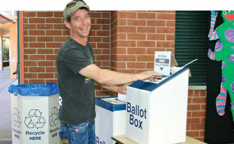 HAPPY VOTER: Joseph Kennard of Suffolk Park exercises his democratic right at Byron Bay Public School on Saturday.