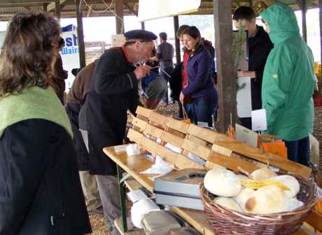 CHEESE PLEASE: Miles King, of Kingsmeade Cheese - seen here (centre) selling his produce - reckons the Solway Showgrounds in the perfect venue for the Saturday markets.