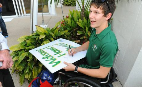 Rheed McCracken signs autographs for Bundaberg fans on his return from the London Paralympics.