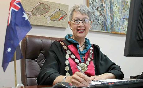 SHE'S BACK: Jenny Dowell, in full robes and mayoral chain, is happy to be back in the mayor's chair.