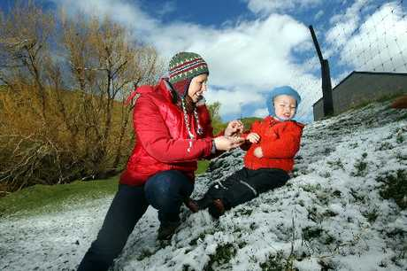 SNOWED IN: Andrea von Lindeiner, of Napier, took her son Lucas Murdock, almost 2, to play in the snow at Rock Station, Te Pohue, on the Napier-Taupo road yesterday. PHOTO/PAUL TAYLOR HBT123762-27