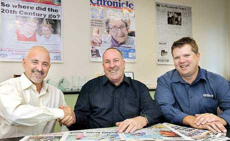 Mat Nott, the new Fraser Coast Chronicle editor, is congratulated by Peter Chapman, the new APN group editor for business, food, travel and shopping, and general manager Darren Bosley.