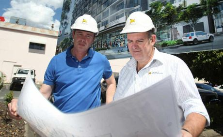 Development partner Andrew Beaumont and JM Kelly general manager John Murphy look over plans for the Empire site, construction of which will start in December.