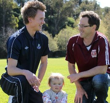 Rovers captain Nick Matheson (left) with his 1-year-old daughter, Holly, and Geon Taradale player/co-coach Warren Gilbertson.