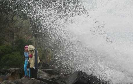 WET AND WILD: Elise, 8, and Noah Luker, 10, brace for a drenching while on a walk on Leisure Island.