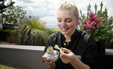 Lexie Jessen eats a wattle and violet sundae from Picnic Point Cafe.