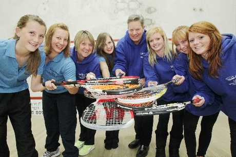 TOP BOAST: Hawke's Bay Squash Rackets Club E graders (from left) Rosemary Mair, Rebecca McIntosh, Michelle Rieter, Alyssa Martin, manager Scotty Applegate, Ashleigh Ennor, Claudette McDonald and Jessica Ennor celebrate after winning the national title in Hastings last night. Absent: Don Matthews.