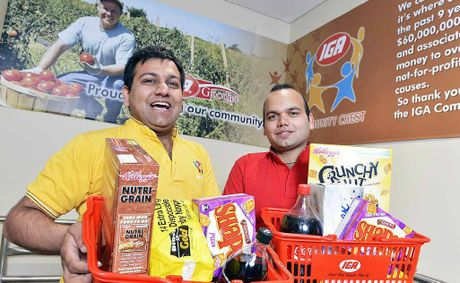 IGA Goodna owners Vishal and Gaurav Bansal have their baskets full.
