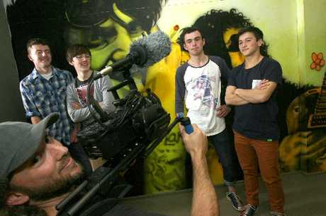 IN SPOTLIGHT: Wairarapa College band Front Back and Sides are Edward Kerr (left), Cameron Elliott, Connor O'Hagan and Emilio McFadzean with Satin & Lace Productions cameraman Warren Green during the filming of a TV series last week.