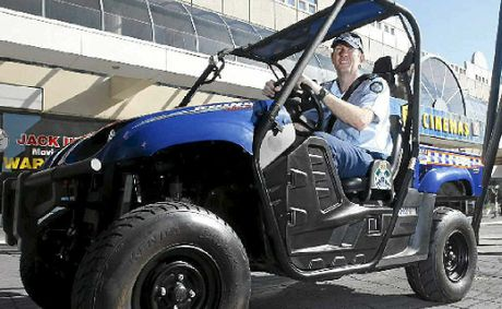 Senior Sergeant Laurie Shevlin in the new police all-terrain vehicle, the Rhino, on trial at Ipswich police station.