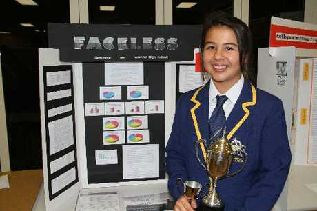 Kate Gear with her winning exhibit and trophies.