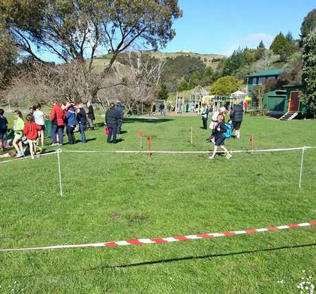 "EFFLUENT: A parent is outraged at pools of sewage wastewater on a Hawke's Bay school's playing field. Tape surrounds a flagged area with pools of boggy ""mud"" evident. PHOTO/SUPPLIED"