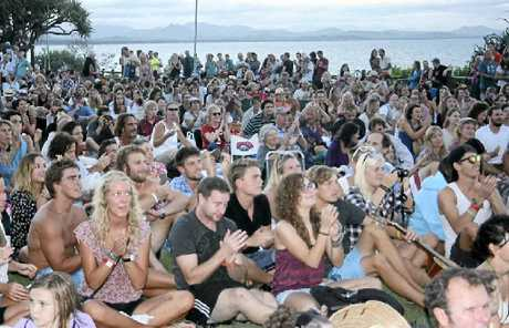 GOOD CROWD: The crowd filled the park beside Byron surf club to watch a movie outdoors at the Byron Bay Film Festival earlier this year.