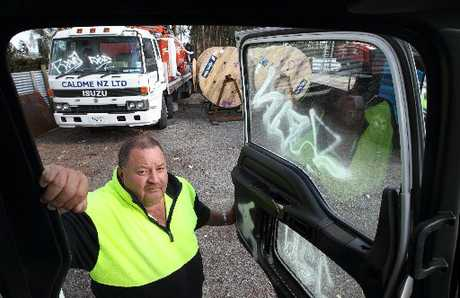 Caldme NZ manager Ed Murray with some of the vehicles that were broken into.