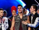Ipswich's X Factor contestant Adil Memon is comforted after receiving news of his elimination.
