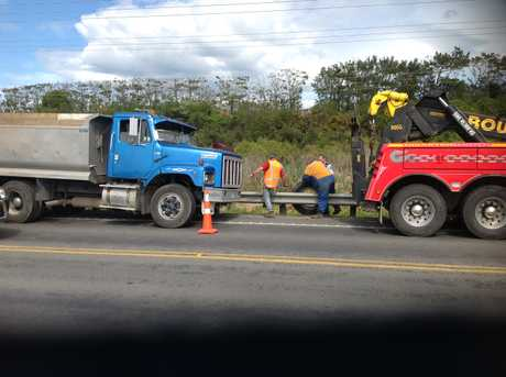 A truck has hit the barrier on SH2