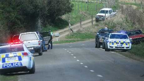 Police investigate the scene of a fatal accident on Awahou Rd near Taneatua yesterday.