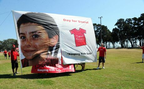 Day for Daniel - Daniel Morcombe Foundation - Bruce Morcombe is the first to break through the new Day for Daniel banner.