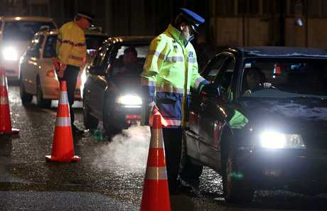Police conduct a drink driving operation.