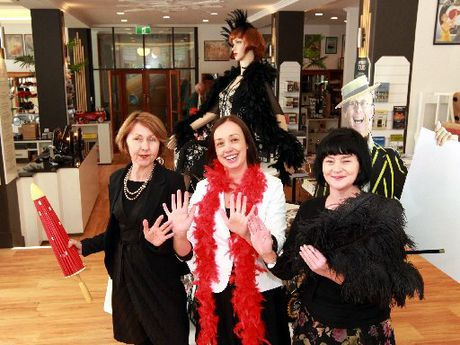Art Deco Trust manager Sally Jackson (centre) with shop crew Lynda Begley (left) and Sarah Nelson in the new-look centre.