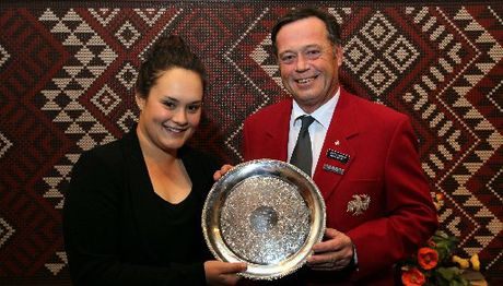 Kate Chadwick receives the Hawke's Bay Eagles Golfing Society's Golfer of the Year award from society president David Howie during the annual Halberg Trust dinner night at the Napier Golf Club last Thursday. Photo / Duncan Brown