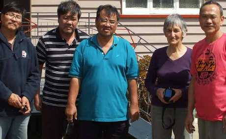 A Yangan resident could not believe it when these gentlemen came knocking on her door last Tuesday. From left, Stanley Yeong, Eric Ung, Marcus Tong, Pam Albury and Felix Ng.