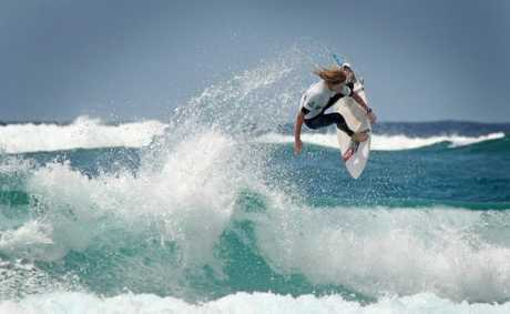 Junior State Surfing Titles at Duranbah beach- Elli Steele takes to the air Photo Blainey Woodham / Daily News