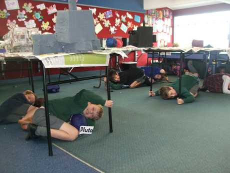 ShakeOut: Students at St Mary's Catholic School took part in the earthquake drill. Pictured are Maryanna Casey's Year 4 class.