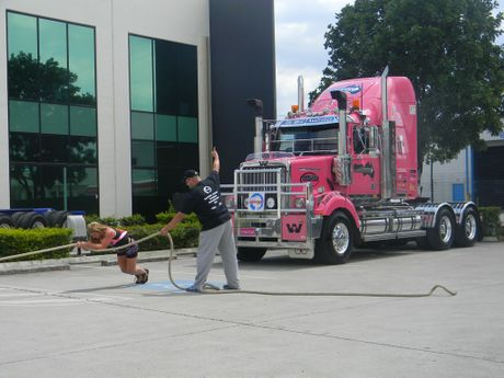 Sue Metcalf pulls a pink Western Star to promte Australian Amateur Strongman Championship. Photo Carly Morrissey / Big Rigs