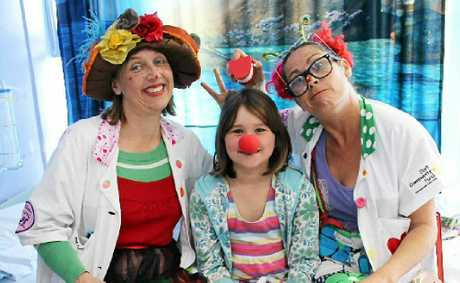 LAUGHTER: Dr Freckles and Dr Sniggles looked after patient Esha Oss-Emer, 9, at Lismore Base Hospital.Photo by Suzannah Lack