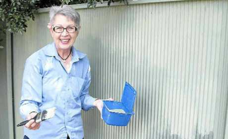 LOOK, NO GRAFFITI: Mayor Jenny Dowell cleans up.